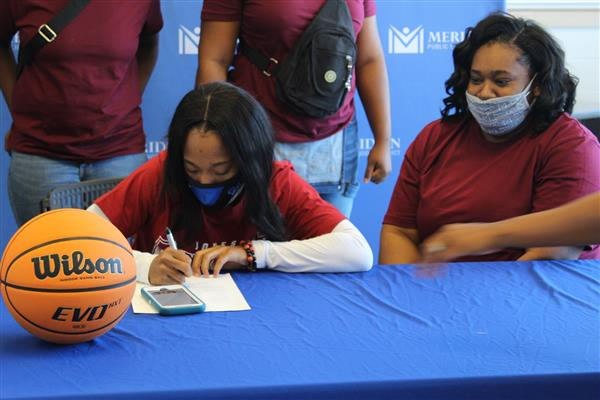 MHS' Arianna Patton signs to play basketball with Jones College in a signing ceremony.