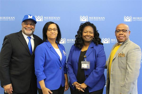 Photo of Dr. Cheyenne Trussell, Dr. Charlotte Young, Dr. Amy Carter, and Principal Victor Hubbard