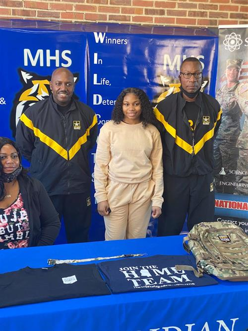 MHS' Jakayla Allen enlists in the Army National Guard during a recent ceremony..